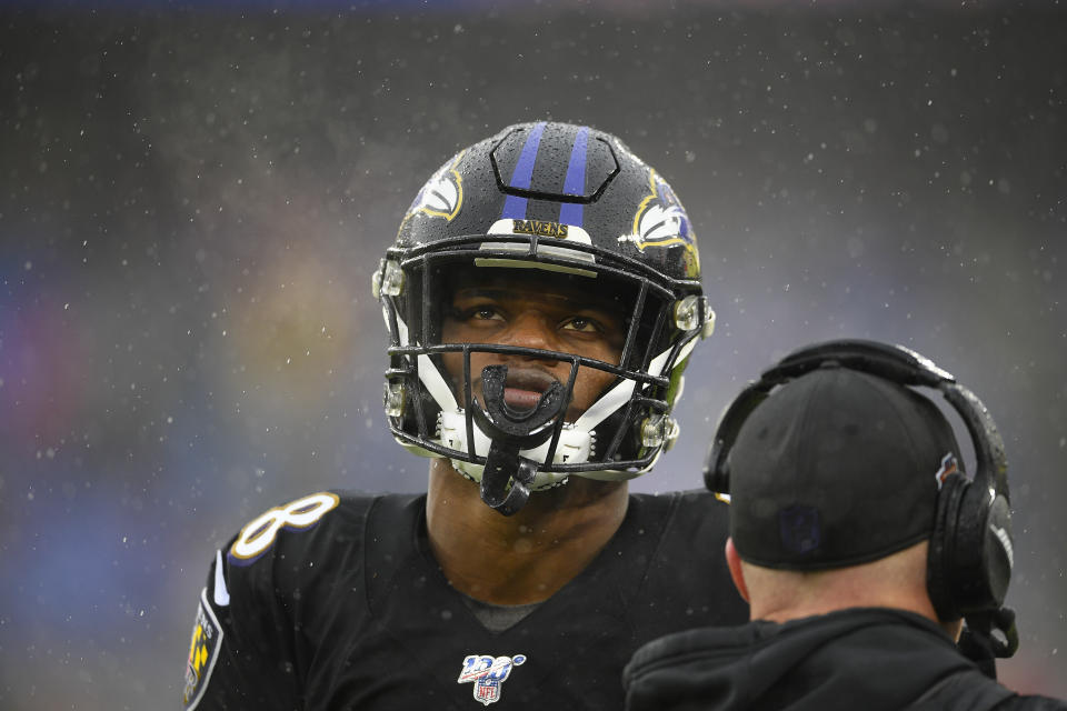 Baltimore Ravens quarterback Lamar Jackson (8) looks up at the scoreboard during the second half of an NFL football game against the San Francisco 49ers, Sunday, Dec. 1, 2019, in Baltimore, Md. (AP Photo/Nick Wass)