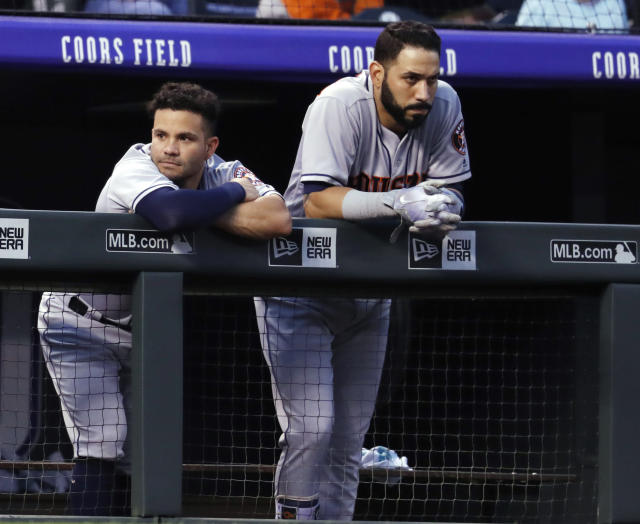 Houston Astros second baseman Jose Altuve, left, leans over the dugout rail next to Marwin Gonzalez during the sixth inning of the team's baseball game against the Colorado Rockies on Wednesday, July 25, 2018, in Denver. (AP Photo/David Zalubowski)