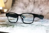 <p>Razer Anzu smart glasses review photo. Slightly right side angled view of the Razer smart glasses sitting on a desk with arms unfolded.</p>