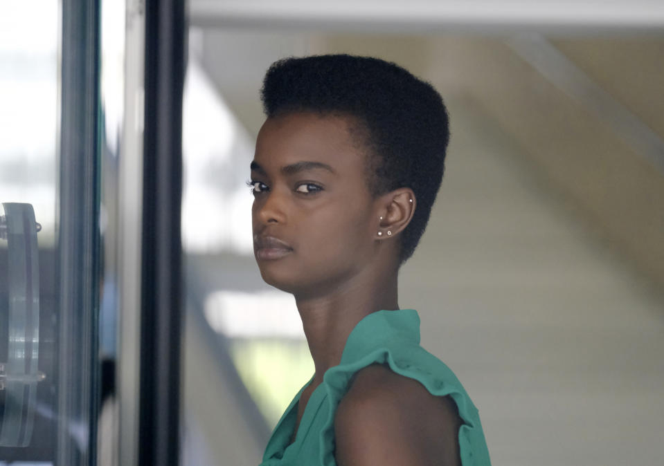 Pictured is Australian-South Sudanese model Adau Mornyang wearing a green top before entering court in LA.