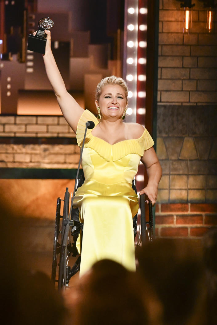 """Ali Stroker accepts the award for best performance by an actress in a featured role in a musical for """"Rodgers & Hammerstein's Oklahoma!""""at the 73rd annual Tony Awards at Radio City Music Hall on Sunday, June 9, 2019, in New York. (Photo by Charles Sykes/Invision/AP)"""