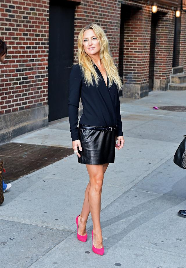 """Kate Hudson wearing a navy top and leather skits at the""""Late Show With David Letterman"""" on April 24, 2013 in New York City."""