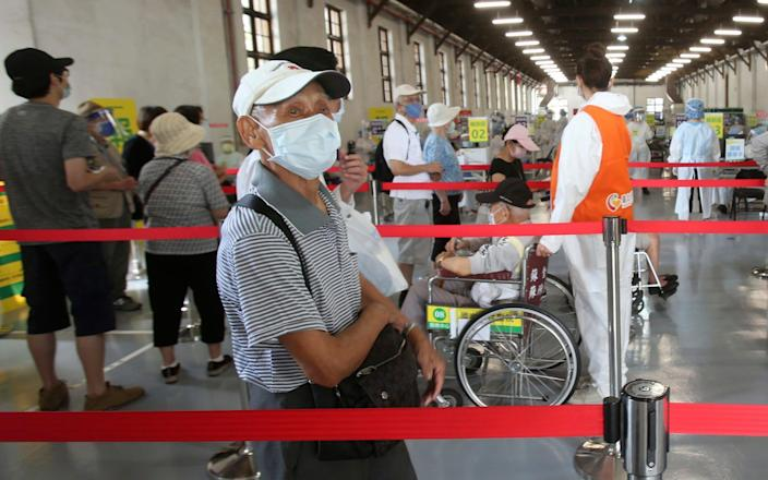 Elderly Taiwanese people wait to receive shots of the AstraZeneca COVID-19 vaccine at Songshan Cultural and Creative Park in Taipei, Taiwan, Wednesday, June 16, 2021. - AP