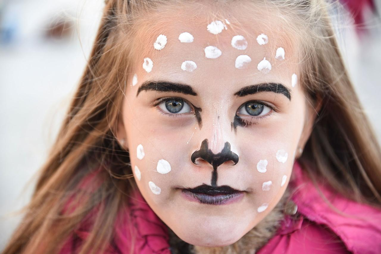 <p>A child wears makeup to participate in an annual Halloween party in central Pristina, Kosovo, on Oct. 31, 2016. (Armend Nimani/AFP/Getty Images) </p>