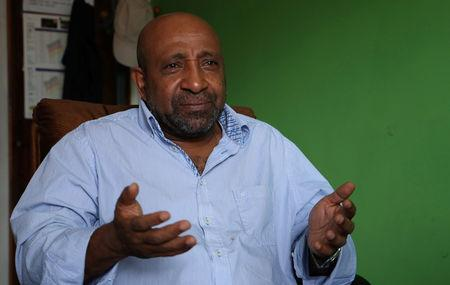 Berhanu Nega, an exiled Ethiopian Ginbot 7 rebel leader speaks during a Reuters interview at his office in Addis Ababa, Ethiopia October 19, 2018. REUTERS/Tiksa Negeri