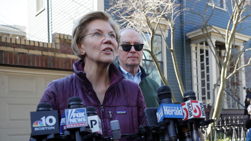 Elizabeth Warren talks to reporters outside her house in Cambridge, Mass., on Thursday. (Brian Snyder/Reuters)
