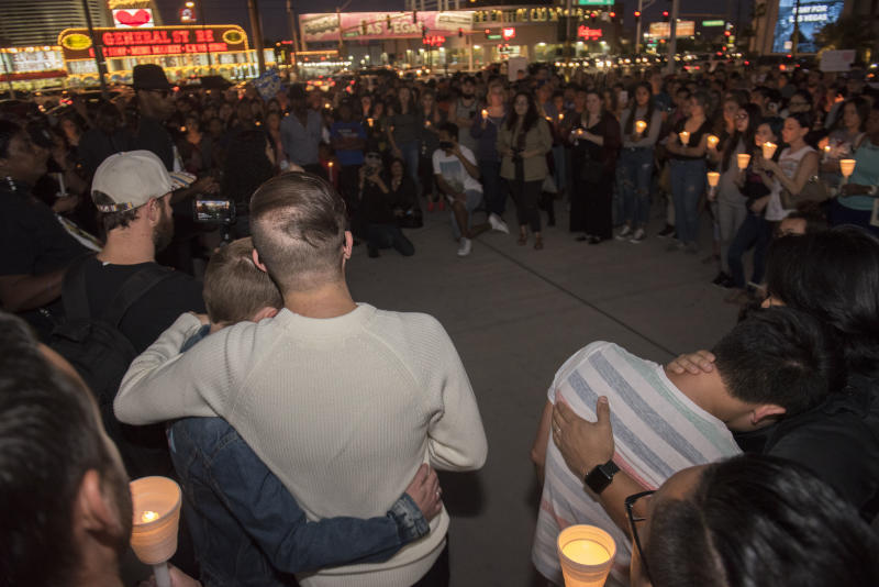 People comfort each other during the vigil.  (Martin S. Fuentes for HuffPost)
