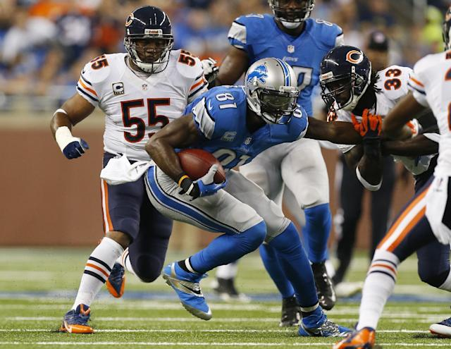 Chicago Bears cornerback Charles Tillman (33) and outside linebacker Lance Briggs (55) close in on Detroit Lions wide receiver Calvin Johnson (81) during the first quarter of an NFL football game at Ford Field in Detroit, Sunday, Sept. 29, 2013. (AP Photo/Paul Sancya)