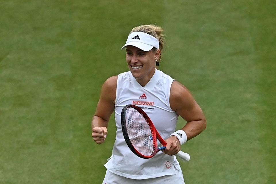 Germany's Angelique Kerber celebrates her victory over Czech Republic's Karolina Muchova during their women's quarter-final tennis match on the eighth day of the 2021 Wimbledon Championships at The All England Tennis Club in Wimbledon, southwest London, on July 6, 2021. - RESTRICTED TO EDITORIAL USE (Photo by Ben STANSALL / AFP) / RESTRICTED TO EDITORIAL USE (Photo by BEN STANSALL/AFP via Getty Images)