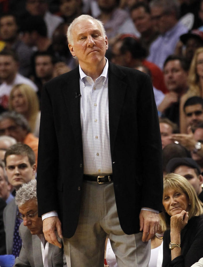 San Antonio Spurs head coach Gregg Popovich watches from the sideline in the second half of an NBA basketball game against the Miami Heat, Thursday, Nov. 29, 2012, in Miami. Miami won 105-100. (AP Photo/Alan Diaz)