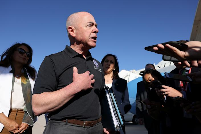 Department of Homeland Security Secretary Alejandro Mayorkas, flanked, right, by Vice President Kamala Harris and, left, Rep. Veronica Escobar, D-Texas, speaks to the media in El Paso, Texas, in June.