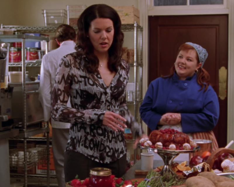 Lorelai usually kept it pretty toned down for work, but this shirt represents a bold departure. It's sort of a distant cousin of Carrie Bradshaw's Galliano newspaper dress, with a much stronger clearance-rack vibe.