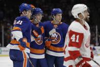 New York Islanders' Otto Koivula (21) and Matt Martin (17) celebrate a goal by Noah Dobson during the second period of an NHL hockey game as Detroit Red Wings' Luke Glendening (41) skates away Tuesday, Jan. 14, 2020, in Uniondale, N.Y. (AP Photo/Frank Franklin II)