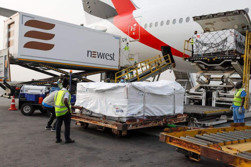Workers offload boxes of AstraZeneca/Oxford vaccines as the country receives its first batch of coronavirus disease (COVID-19) vaccines under COVAX scheme, in Accra
