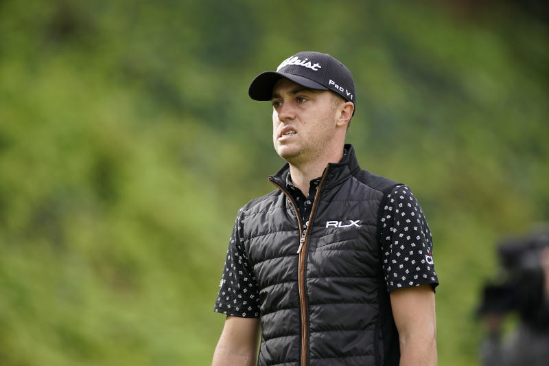 Justin Thomas grimaces after hitting his tee shot into the rough on the seventh hole as first round play continues during the Genesis Open golf tournament at Riviera Country Club on Friday, Feb. 15, 2019, in the Pacific Palisades area of Los Angeles. (AP Photo/Ryan Kang)