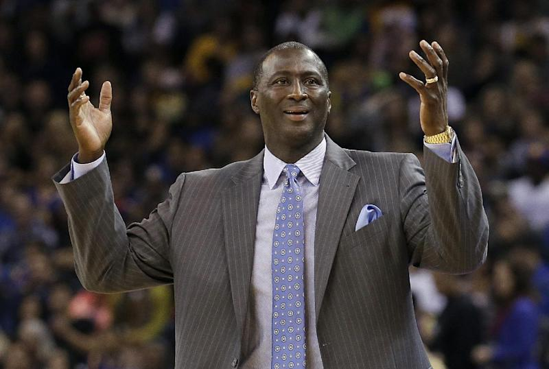 Utah Jazz head coach Tyrone Corbin gestures after an official's call during the second quarter of an NBA basketball game against the Golden State Warriors in Oakland, Calif., Saturday, Nov. 16, 2013. (AP Photo/Jeff Chiu)