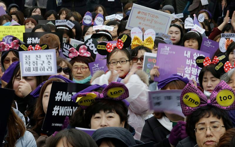 A South Korean girl is among people supporting the MeToo movement during a rally to mark International Women's Day in Seoul - AP