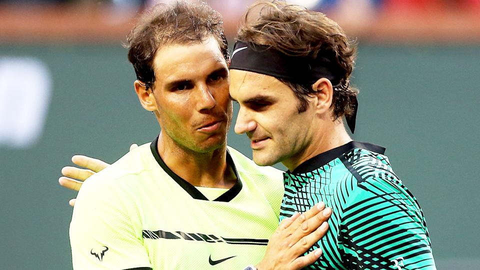 Roger Federer (pictured right) hugging and Rafa Nadal (pictured left) after the Spaniard's win.