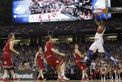 Kentucky's Terrence Jones (3) dunks the ball against an Indiana defense during the first half of an NCAA tournament South Regional semifinal college basketball game Friday, March 23, 2012, in Atlanta. (AP Photo/David J. Phillip)