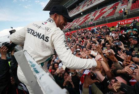 Formula One F1 - Spanish Grand Prix - Circuit de Barcelona-Catalunya, Barcelona, Spain - May 13, 2018 Mercedes' Lewis Hamilton celebrates with fans after winning the race REUTERS/Albert Gea