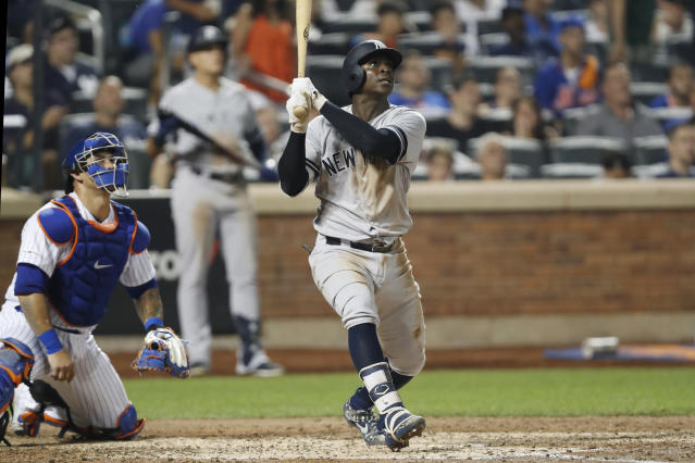 New York Yankees' Didi Gregorius watches his solo home run next to New York Mets catcher Wilson Ramos during the sixth inning of a baseball game Wednesday, July 3, 2019, in New York. (AP Photo/Kathy Willens)