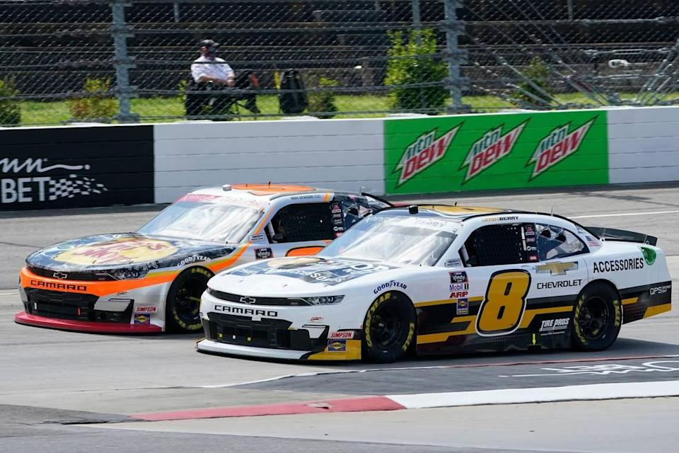 Josh Berry (8) and Noah Gragson, left, drive into turn turn two during start of the rain delayed NASCAR Xfinity Series auto race at Martinsville Speedway in Martinsville, Va., Sunday, April 11, 2021. (AP Photo/Steve Helber)