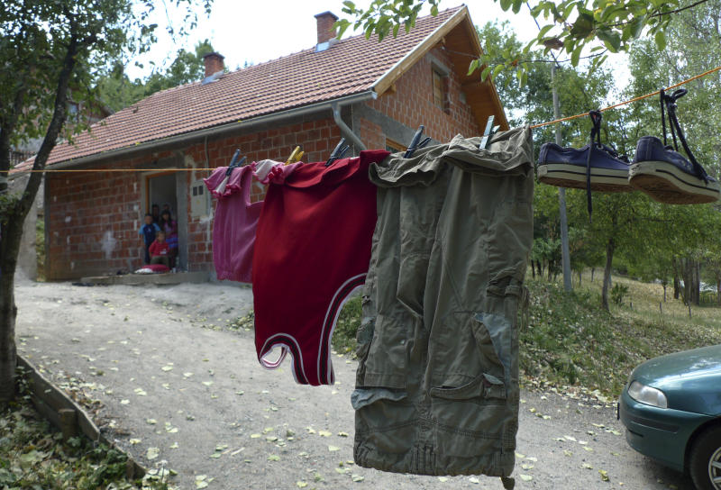 In this Saturday Aug. 11, 2012 photo the clothes in which 6-year-old Tarik Bijelic died hang on the line in front of his family's small house in the village of Olovske Luke, 60 kilometers north of Sarajevo, Bosnia. Tarik Bijelic was hit by a land mine last week as he scavenged in the forest for firewood to help his family make ends meet. He died in his father's arms. Under an international treaty, Bosnia was supposed to be free of mines by 2009. Instead, it has quietly obtained another decade to clear the estimated 1,300 remaining square kilometers (500 square miles) of mine fields. In the 16 years since Bosnia's three-year war ended, mines have killed 591 people. So far this year, seven people have been killed and 3 maimed. (AP Photo/Amel Emric)