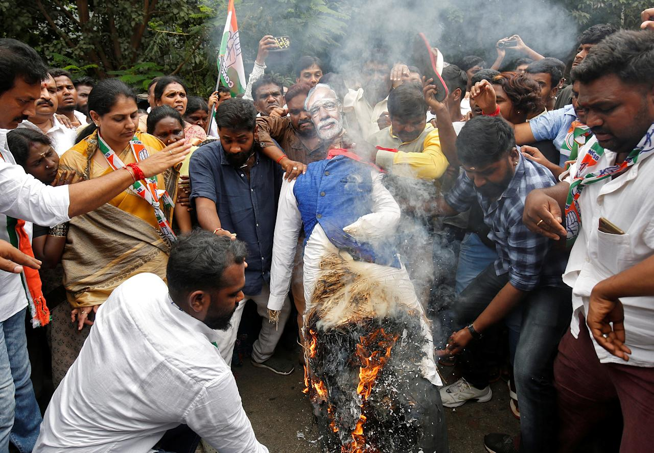 <p>Supporters of India's main opposition Congress party burn an effigy of India's Prime Minister Narendra Modi during a nationwide protest against hike in fuel prices, in Bengaluru, India, September 10, 2018. REUTERS/Abhishek N. Chinnappa </p>