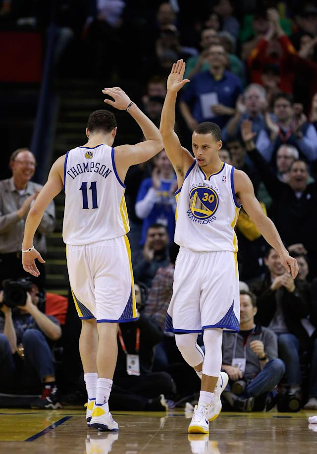 OAKLAND, CA - JANUARY 23: Stephen Curry #30 of the Golden State Warriors is congratulated by Klay Thompson #11 after Curry made a basket and was fouled during their game against the Oklahoma City Thunder at Oracle Arena on January 23, 2013 in Oakland, California. NOTE TO USER: User expressly acknowledges and agrees that, by downloading and or using this photograph, User is consenting to the terms and conditions of the Getty Images License Agreement. (Photo by Ezra Shaw/Getty Images)