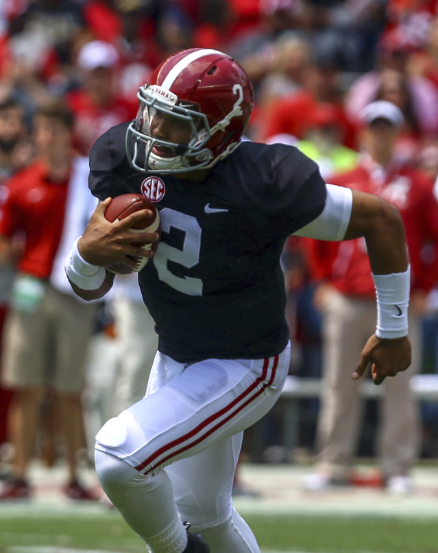 Quarterback Jalen Hurts (2) scrambles for a first down during the first half of an NCAA college football Alabama Spring game, Saturday, April 21, 2018, in Tuscaloosa, Ala. (AP Photo/Butch Dill)