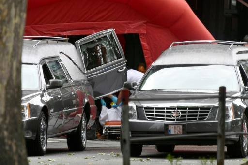 Hearses came to the scene of the shooting in Liege, where the attacker shot dead three people
