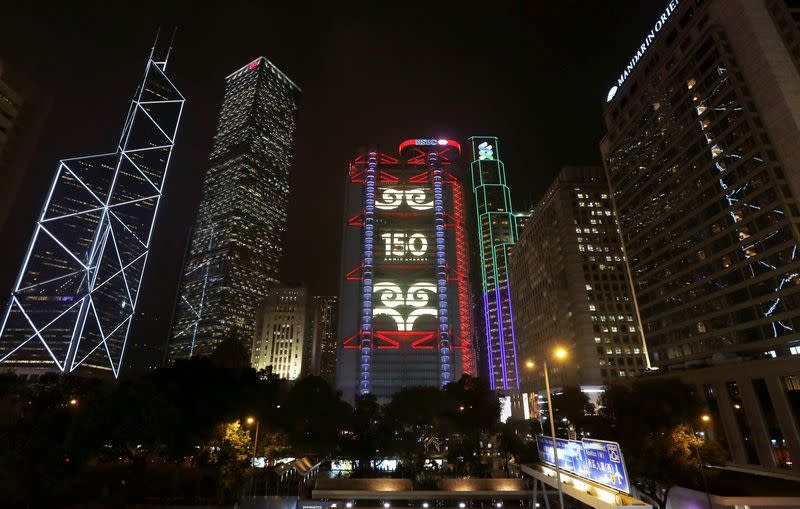 """A lighting show displays """"150 anniversary"""" on HSBC headquarters in Hong Kong"""
