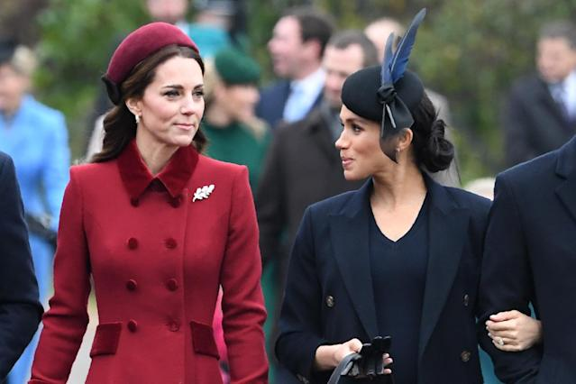 Britain's Catherine, Duchess of Cambridge (L) talks to Meghan, Duchess of Sussex as they arrive for the Royal Family's traditional Christmas Day service at St Mary Magdalene Church in Sandringham, Norfolk, eastern England, on December 25, 2018. (Photo by Paul ELLIS / AFP) (Photo credit should read PAUL ELLIS/AFP/Getty Images)