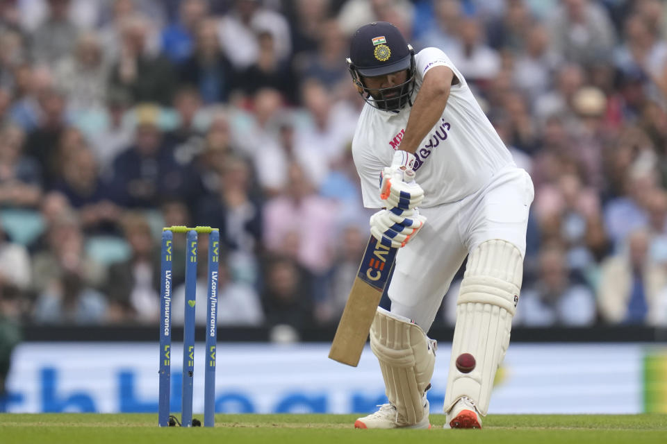India's Rohit Sharma plays a shot off the bowling of England's Chris Woakes on day three of the fourth Test match at The Oval cricket ground in London, Saturday, Sept. 4, 2021. (AP Photo/Kirsty Wigglesworth)