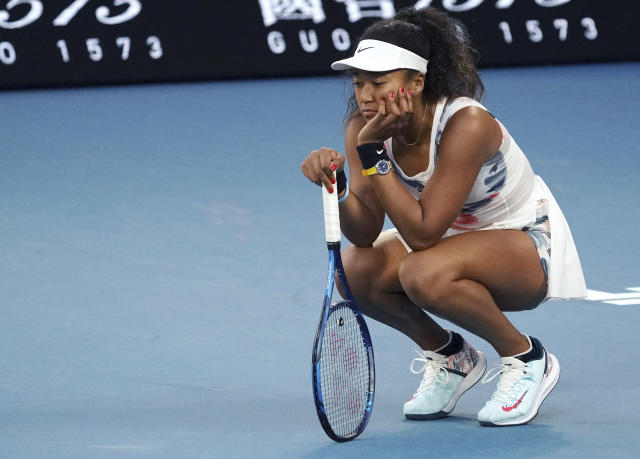 FILE - In this Jan. 24, 2020, file photo, Japan's Naomi Osaka reacts during her third round loss to Coco Gauff of the United States, at the Australian Open tennis championship in Melbourne, Australia. The two-time Grand Slam champion says she is disappointed that the Olympics in her native Japan were postponed because of the coronavirus pandemic, but she supports the decision to delay the Summer Games to 2021. (AP Photo/Lee Jin-man, File)