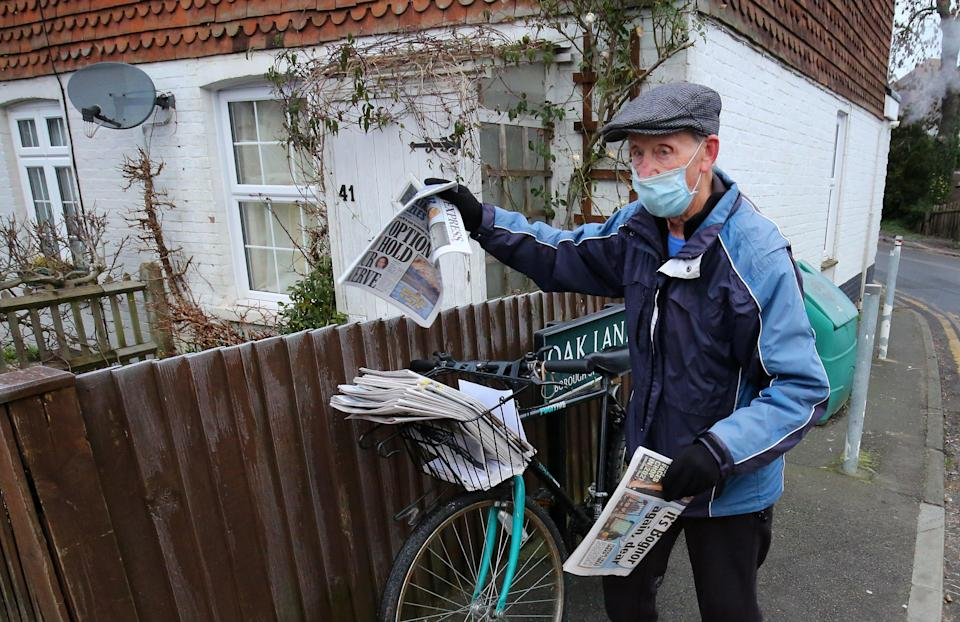 George Bailey, of Headcorn near Maidstone in Kent, one of the oldest paperboys in the country, returns to work after celebrating his birthday.PA