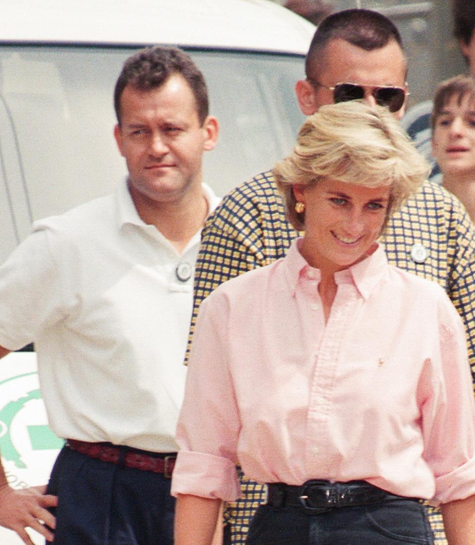 Paul Burrell (left, in the background in the white shirt and black trousers, butler to Diana, Princess of Wales as she makes a three day visit to Bosnia - Herzegovina as part of her campaign to raise awareness about the devastating effects landmines have on peoples lives and to call for a complete ban on the production, sale and use of land mines. The trip was organised by the American-based Landmine Survivors Network. Picture taken 10th August 1997. (Photo by Kent Gavin/Mirrorpix/Getty Images)