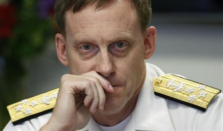 NSA Director Adm. Michael Rogers listens at Reuters CyberSecurity Summit in Washington