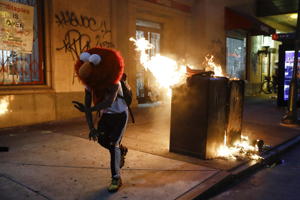 A protester in an Elmo mask dances during the Justice for George Floyd Philadelphia Protest on Saturday, May 30, 2020. (AP Photo/Matt Rourke)