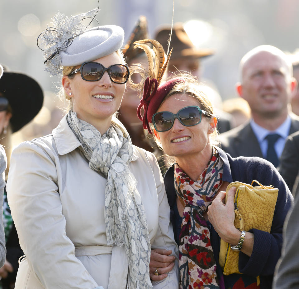 CHELTENHAM, UNITED KINGDOM - MARCH 14: (EMBARGOED FOR PUBLICATION IN UK NEWSPAPERS UNTIL 48 HOURS AFTER CREATE DATE AND TIME) Zara Phillips and Dolly Maude watch the racing as they attend Day 4 of the Cheltenham Festival at Cheltenham Racecourse on March 14, 2014 in Cheltenham, England. (Photo by Max Mumby/Indigo/Getty Images)