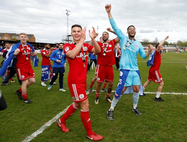 "Soccer Football - League Two - Accrington Stanley v Lincoln City - Wham Stadium, Accrington, Britain - April 28, 2018 Accrington Stanley players celebrate winning promotion after the match Action Images/Andrew Boyers EDITORIAL USE ONLY. No use with unauthorized audio, video, data, fixture lists, club/league logos or ""live"" services. Online in-match use limited to 75 images, no video emulation. No use in betting, games or single club/league/player publications. Please contact your account representative for further details."