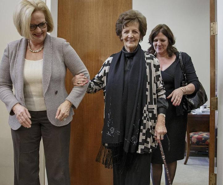 Philomena Lee, center, an Irish woman whose search for the son that she gave up for adoption in the 1950's, and is now a Hollywood film, meets with Sen. Claire McCaskill, D-Mo., left, on Capitol Hill in Washington, Thursday, Jan. 30, 2014. With her life story now the subject of an Oscar-nominated film, Philomena Lee is calling for government reforms in Ireland that would grant adopted people access to adoption files. Her daughter, Jane Libberton, follows at rear. (AP Photo)