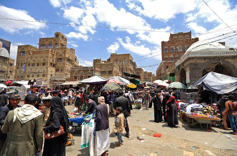 Yemenis shop in a market in the old city of the capital Sanaa, as the faithful prepare for the Muslim holy fasting month of Ramadan, on May 2, 2019 (AFP Photo/Mohammed HUWAIS)