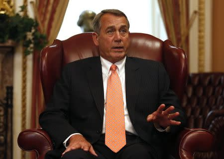 U.S. House Speaker Boehner talks to reporters during his meeting with Australian Prime Minister Tony Abbott at the U.S. Capitol building in Washington