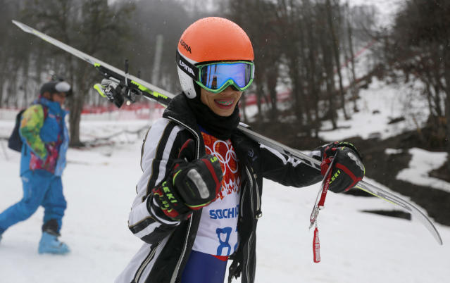 Violinst Vanessa Mae, starting under her father's name as Vanessa Vanakorn for Thailand, leaves after competing in the first run of the women's giant slalom at the Sochi 2014 Winter Olympics, Tuesday, Feb. 18, 2014, in Krasnaya Polyana, Russia. (AP Photo/Gero Breloer)