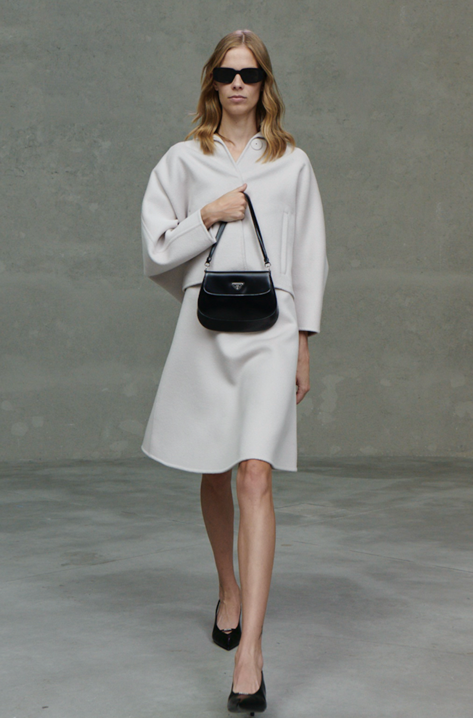 """<p>Prada's resort 2021 collection was presented in five different videos, each one created by individuals (Terence Nance, Joanna Piotrowska, Martine Syms, Juergen Teller, and Willy Vanderperre) with various perspectives on the collection. """"This is an embracing and celebration of that multiplicity—when people cannot commune, we can establish a different type of community, united through ideas, goals, beliefs,"""" said the fashion house in a statement. The clothing itself in this collection were pared down and unostentatious.</p>"""