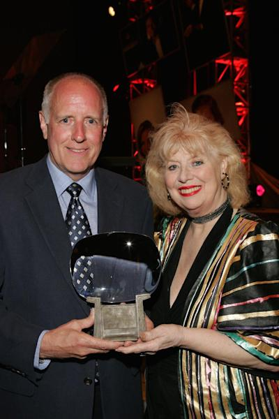 """This June 26, 2004 photo provided by the Academy of Television Arts & Sciences shows Brian Carney, left, with the Hall of Fame honor given posthumously to Art Carney accepted on his behalf by his son, and actress Sheila MacRae who presented it at the 16th Hall of Fame induction ceremony in Los Angeles. The veteran stage, film and TV performer, MacRae, best known for playing Alice Kramden in the 1960s re-creation of """"The Honeymooners"""" has died. MacRae's granddaughter, Allison Mullavey, on Friday, March 7, 2014, told The Associated Press that the actress died Thursday at the Lillian Booth Actors Home in Englewood, New Jersey. (AP Photo/Academy of Television Arts & Sciences, Mathew Imaging/Filmmagic)"""