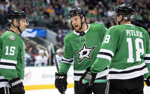 Dallas Stars center Radek Faksa, center, of the Czech Republic, confers with Blake Comeau (15) and Tyler Pitlick (18) during the first period of an NHL hockey game Thursday, Nov. 8, 2018, in Dallas. (AP Photo/Jeffrey McWhorter)