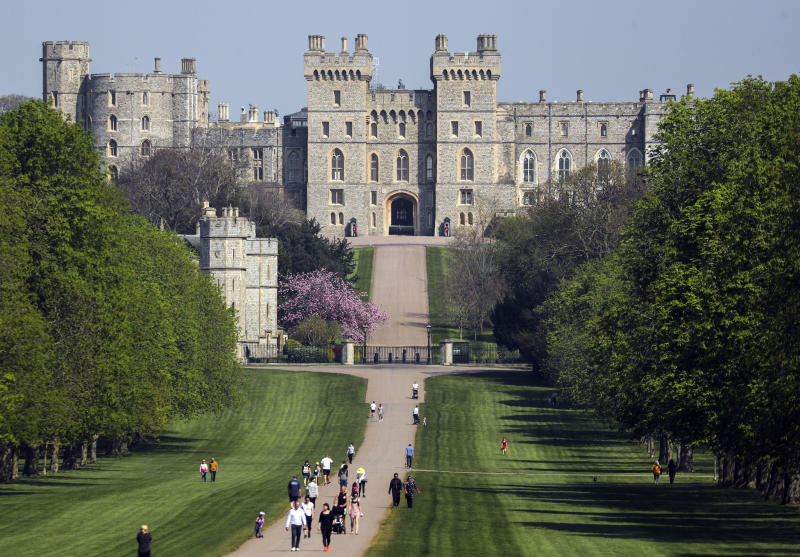 People on the Long Walk at Windsor Castle, Berkshire, during the Easter bank holiday weekend, as the UK continues in lockdown to help curb the spread of the coronavirus. (Photo by Steve Parsons/PA Images via Getty Images)
