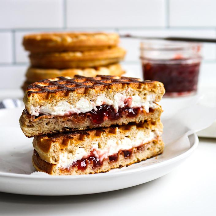 <p>Frozen waffles might not seem like much on their own, but filling them with a sweet and savory combo of jam and goat cheese takes them to a new level. Assemble and toast multiple sandwiches at once, then freeze them to heat-and-eat on demand. Look for high-protein frozen waffles to bump up the satiety factor.</p>